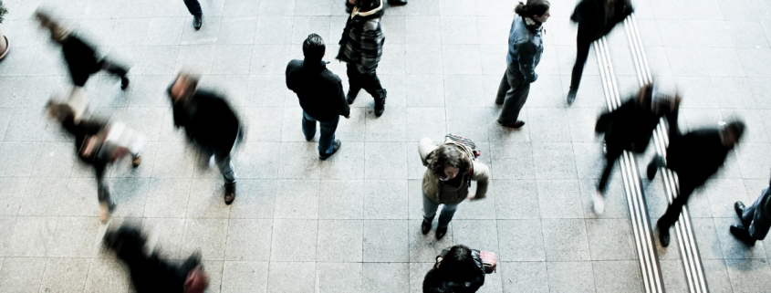 Featured image of people walking through a busy intersection