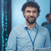 Security engineer standing in front of cloud data centre